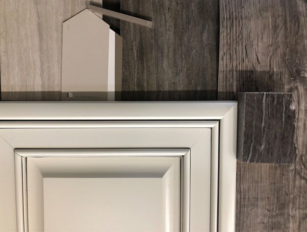 Glazed white cabinets and dark quartzite countertops offer contrast in this home with a built-in RV garage. Come design your new home in Grand Junction!