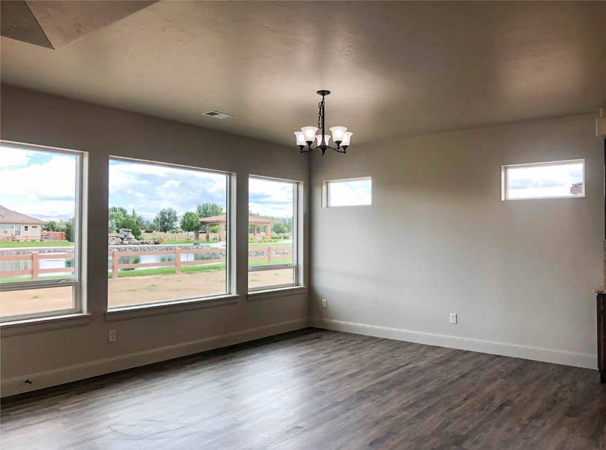 The dining room of the Sapphire has large windows looking over the back yard, and offers space for a hutch against the side wall.