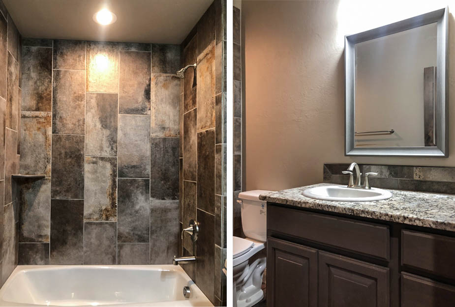 The hall bath in the Ruby model includes a custom tiled cast iron tub & with a shower head, toilet, and vanity.