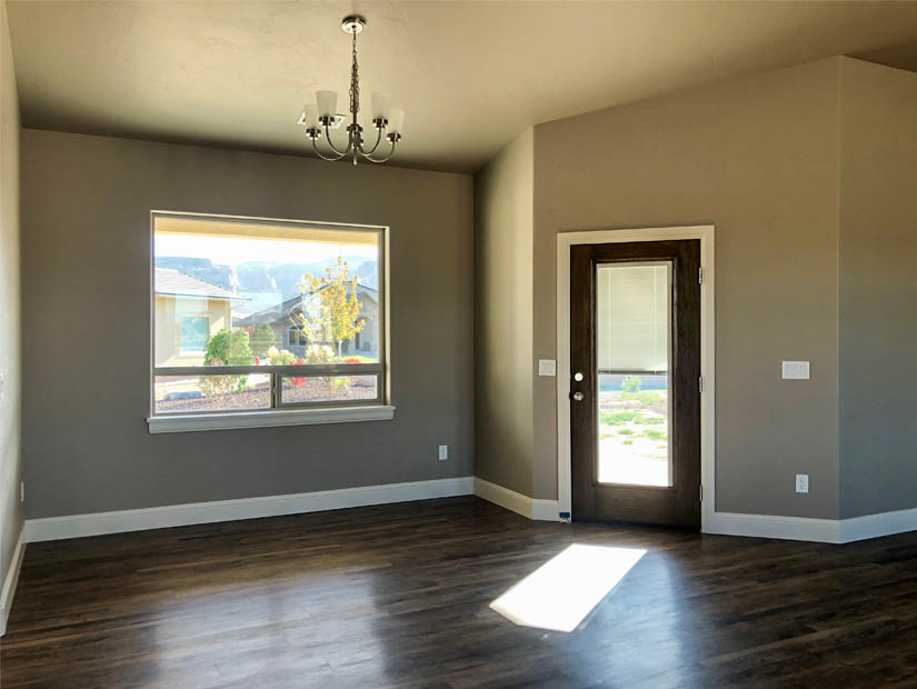 The dining room of the Ruby model looks out over the back yard and has access to the back patio.