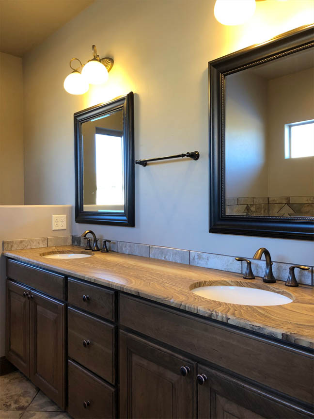 The extra long vanity in the Ruby's master bath offers 2 sinks and countertop space.