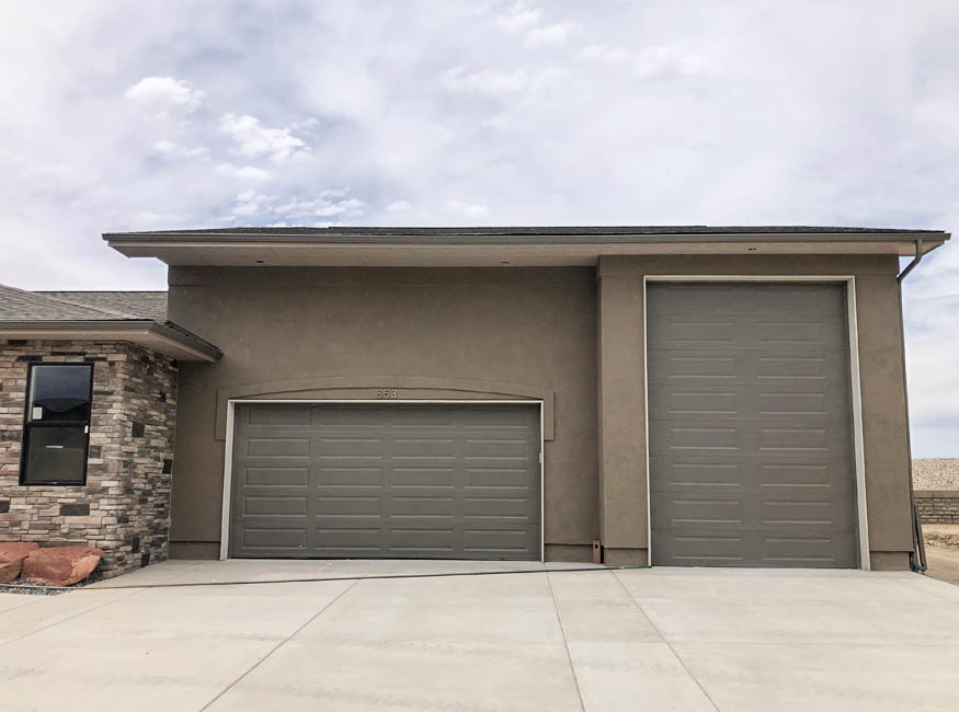The 2-car plus RV Garage on the Topaz model offers space to park a small to medium RV, boat, ATV's, etc inside the garage, protecting them from the weather.